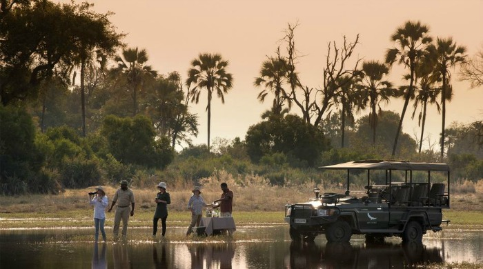 People on safari in Botswana.