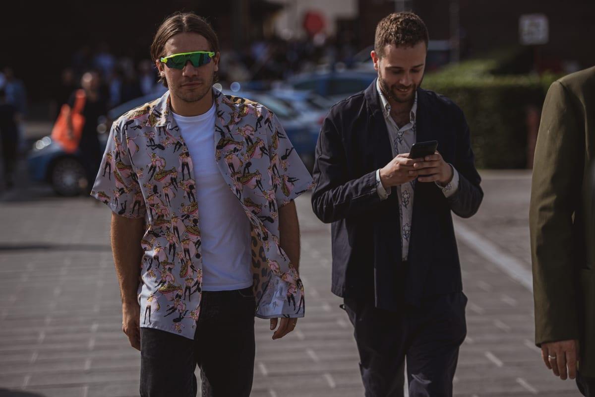 Two men wearing printed shirts
